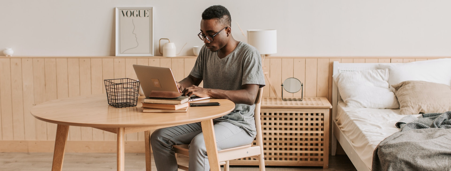 Student studying in bedroom at table