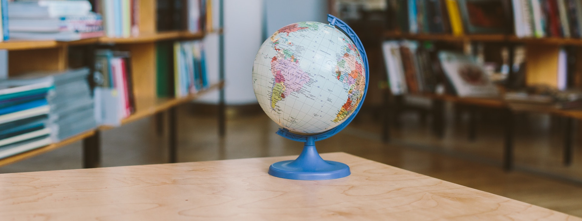 Globe sitting on table in library