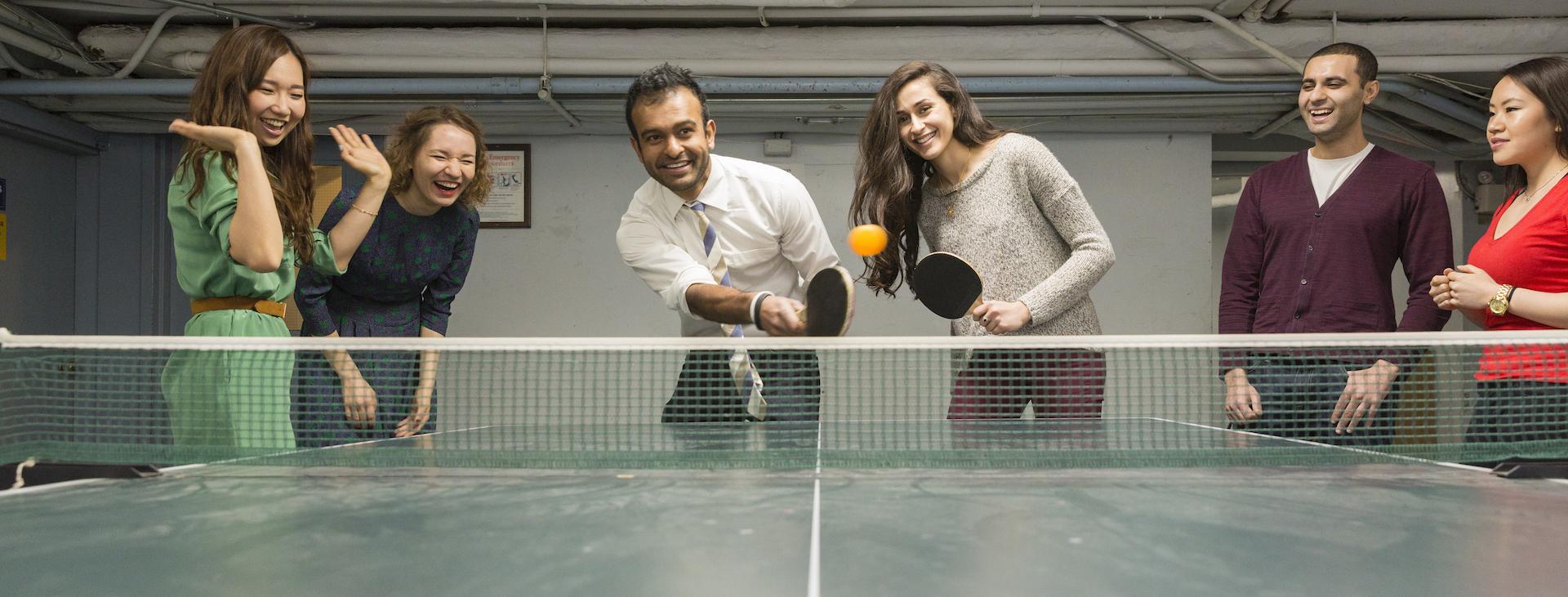 Grad students playing ping pong