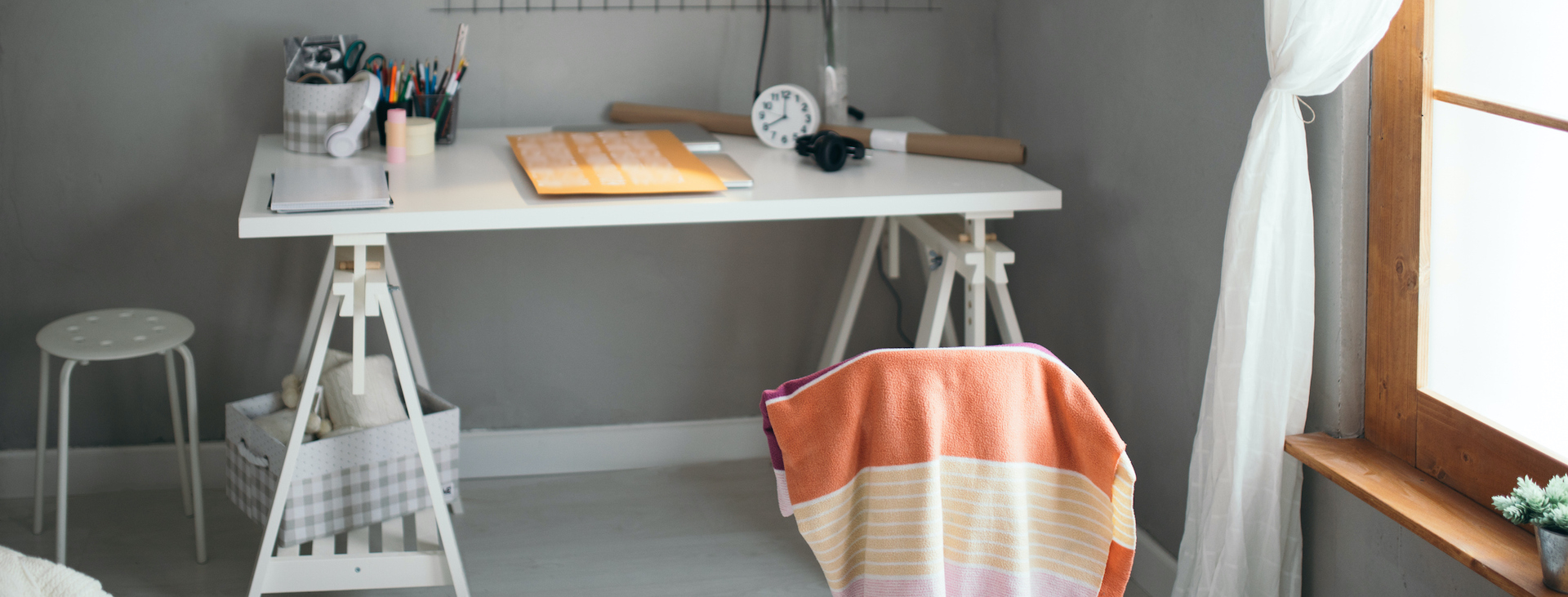 Student's desk at home beside window