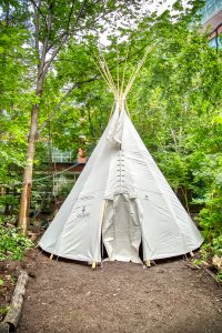 First Nations House Tipi raised in north courtyard of Earth Sciences Centre.