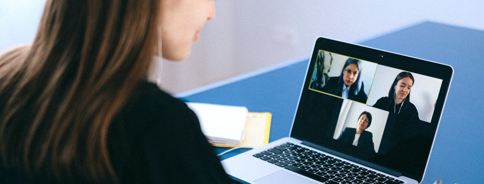 Woman at desk on video call
