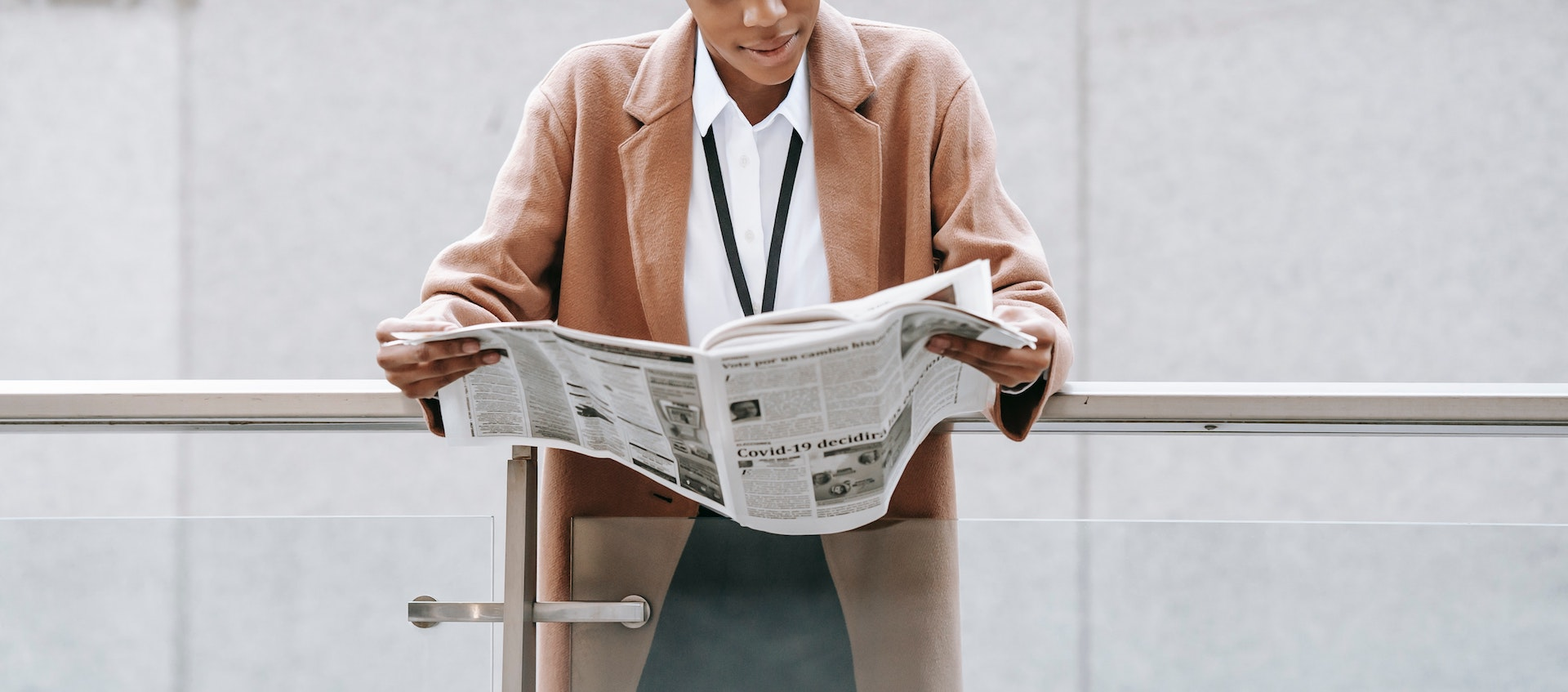 professional woman reading paper