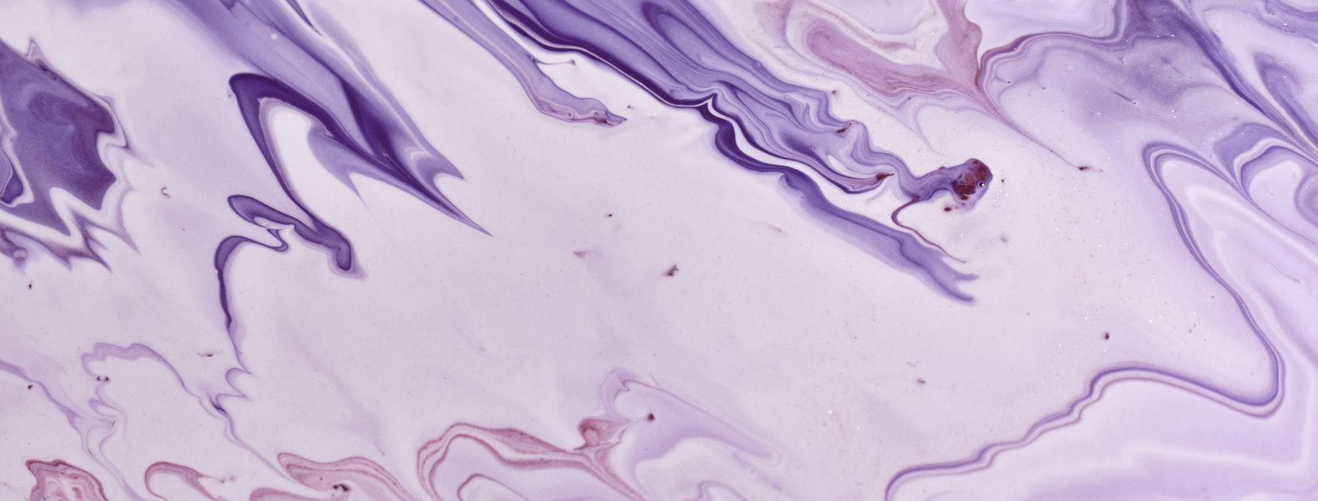 Purple abstract paint swirl