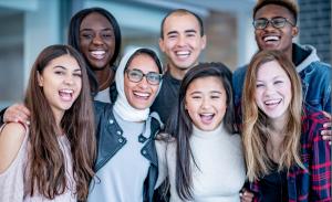 Seven students smiling together